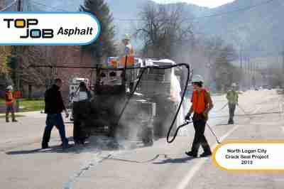 Top Job Asphalt - Crack sealing city streets.