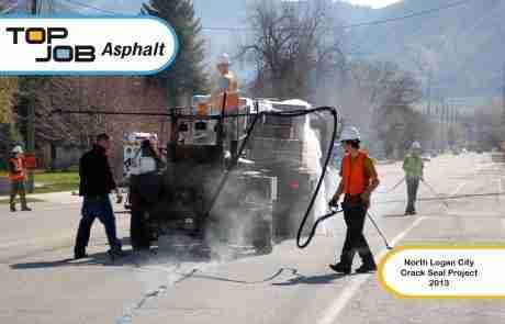 Top Job Asphalt - Crack sealing city streets.