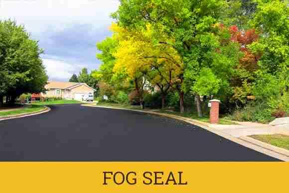 Fog seal municipal asphalt maintenance