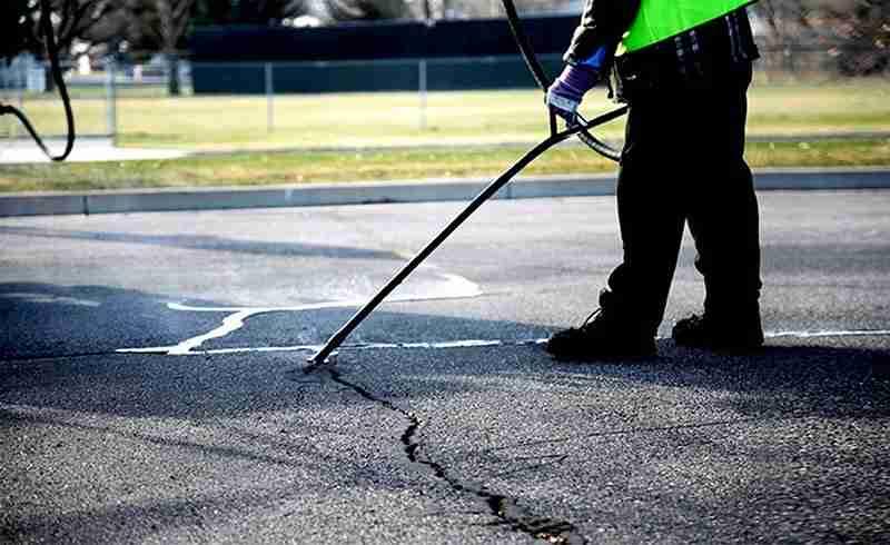 crack sealing asphalt pavement reduces asphalt paving costs