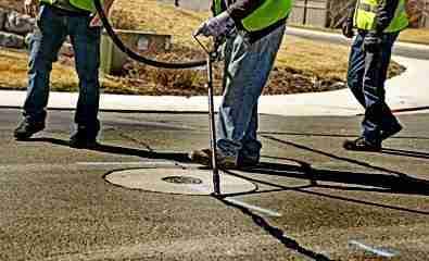 crack sealing around manhole cover