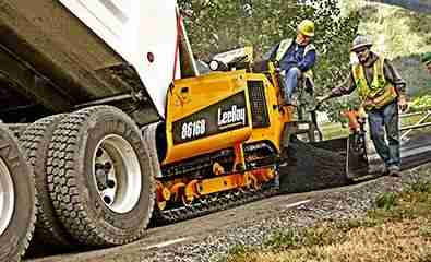 asphalt paving crew operating a paver